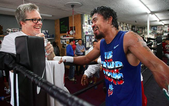 Nov. 27, 2012, Hollywood, Calif.  ---  Filipino boxer Manny Pacquiao talks with trainer Freddie Roach, left,  at the Wildcard Boxing Club as he prepares for the upcoming fourth fight of his rivalry against Mexican boxer Juan Manuel Marquez. The boxers will fight for the fourth time when they battle at the MGM Grand Garden Arena in Las Vegas on Saturday, Dec. 8, 2012.