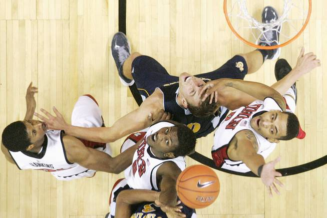 UNLV's Justin Hawkins, Savon Goodman and Anthony Marshall contest a rebound with UC Irvine forwards Adam Folker and Will Davis II (partially seen) during their game Wednesday, Nov. 28, 2012 at the Thomas & Mack. UNLV won the game 85-57.