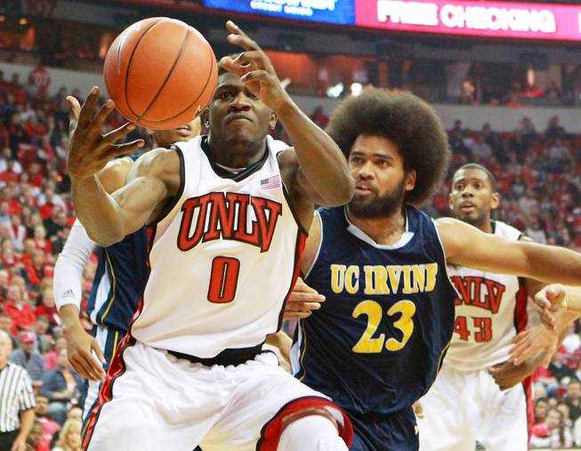 UNLV forward Savon Goodman grabs a rebound from UC Irvine forward Michael Wilder during their game Wednesday, Nov. 28, 2012 at the Thomas & Mack. UNLV won the game 85-57.
