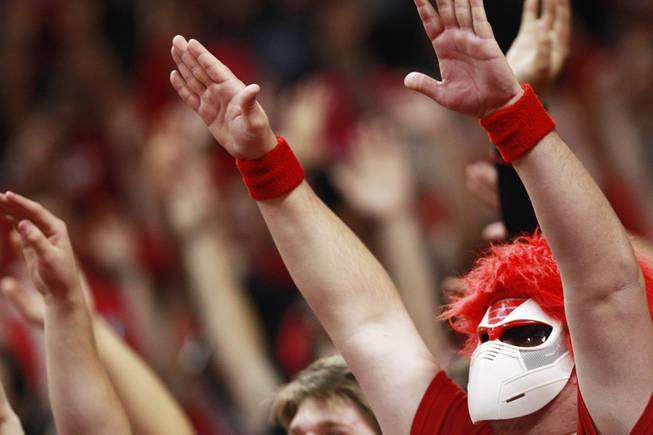 UNLV fans hold their arms up during a free throw during their game against UC Irvine Wednesday, Nov. 28, 2012 at the Thomas & Mack. UNLV won the game 85-57.