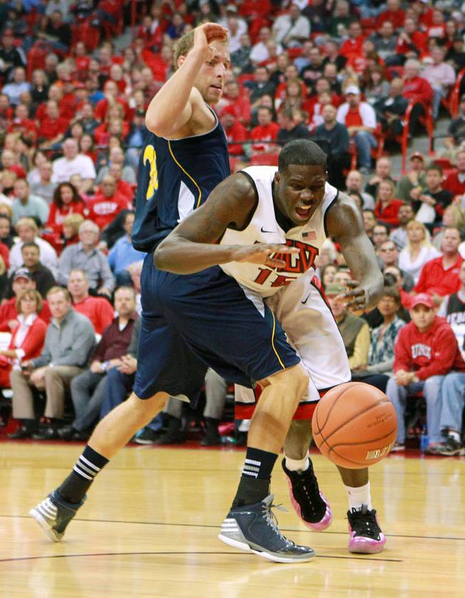 UNLV forward Anthony Bennett is fouled by UC Irvine forward Adam Folker during their game Wednesday, Nov. 28, 2012 at the Thomas & Mack. UNLV won the game 85-57.