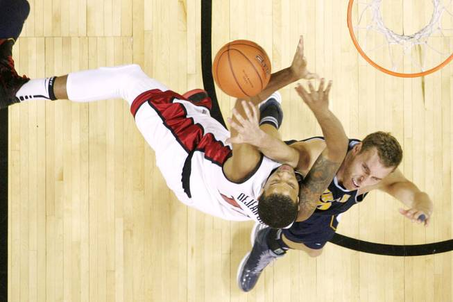 UNLV guard Bryce Dejean-Jones is fouled by UC Irvine forward Adam Folker during their game Wednesday, Nov. 28, 2012 at the Thomas & Mack. UNLV won the game 85-57.
