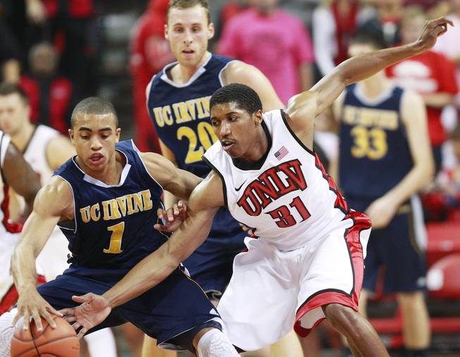 UNLV guard Justin Hawkins defends UC Irvine guard Alex Young during their game Wednesday, Nov. 28, 2012 at the Thomas & Mack. UNLV won the game 85-57.