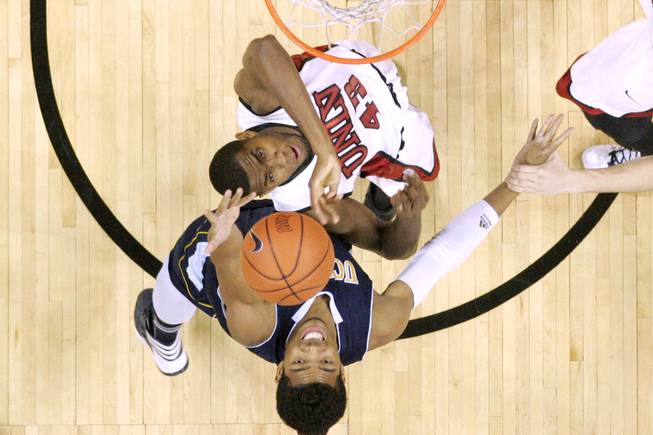 UNLV forward Mike Moser and UC Irvine forward Will Davis II reach for a rebound during their game Wednesday, Nov. 28, 2012 at the Thomas & Mack. UNLV won the game 85-57.