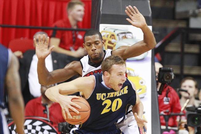 UNLV forward Mike Moser guards UC Irvine forward Adam Folker during their game Wednesday, Nov. 28, 2012 at the Thomas & Mack. UNLV won the game 85-57.