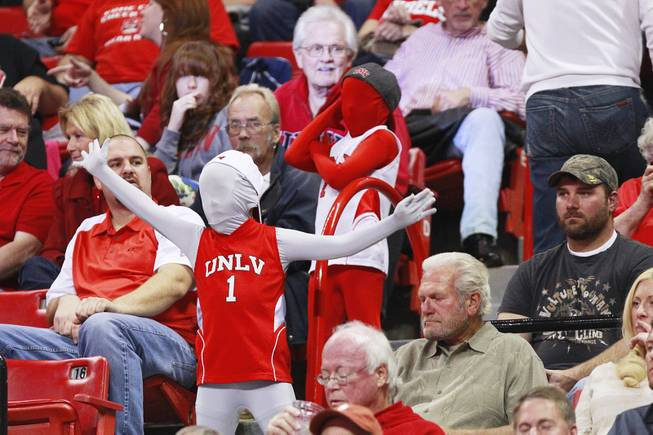 Two masked UNLV fans dance in the aisle during their game against UC Irvine Wednesday, Nov. 28, 2012 at the Thomas & Mack. UNLV won the game 85-57.