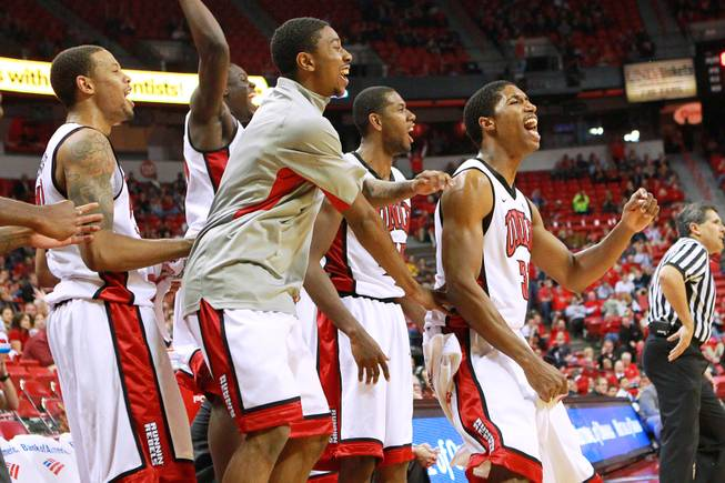 UNLV players celebrate after teammate Barry Cheaney made a basket against UC Irvine during their game Wednesday, Nov. 28, 2012 at the Thomas & Mack. UNLV won the game 85-57.
