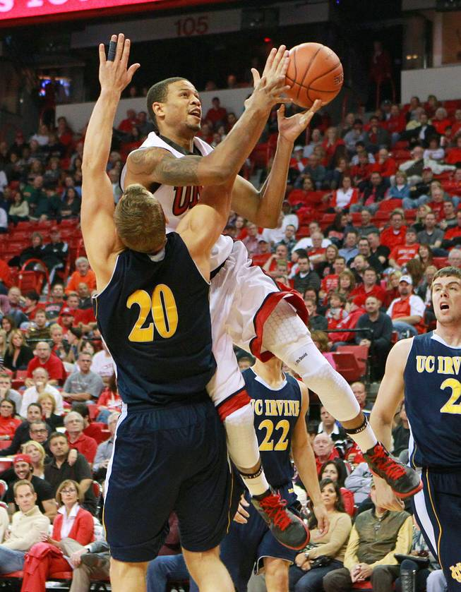 UNLV guard Bryce Dejean-Jones shoots over UC Irvine forward Adam Folker during their game Wednesday, Nov. 28, 2012 at the Thomas & Mack. UNLV won the game 85-57.