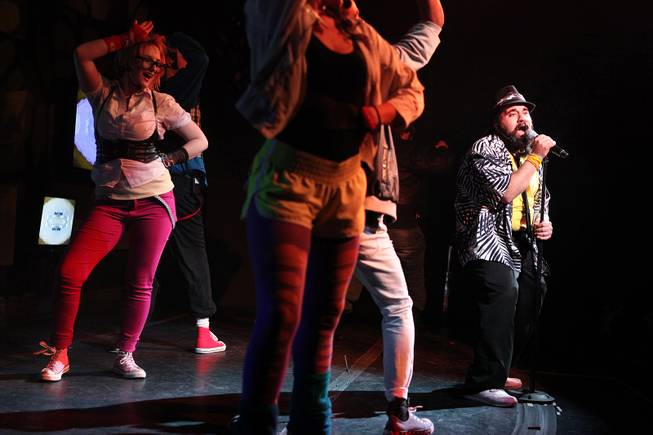 "John Tomasello, right, performs as Chris Cruise during the grand opening performance of ""Legwarmers: An 80s Musical' at V Theater inside Planet Hollywood in Las Vegas on Wednesday, November 28, 2012."