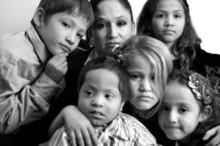 Almalinda Guerrero-Gonzales, center, with her children, from left, James Matthew Gonzales, 7, Henry James Gonzales, 3, Almalinda Gonzales, 7, Zabraamalatzka Rosales-Gonzales, 8, and Maria Guadalupe Gonzales, 5, at their home in Las Vegas on Wednesday, November 28, 2012. All of the Gonzales children have some sort of physical or mental disability.