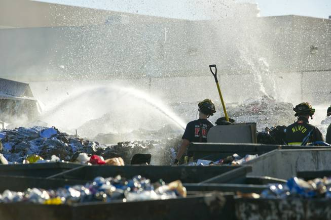 North Las Vegas Firefighters battle a fire at Secured Fibres, a recycling and waste management company near Craig Road and Interstate 15, Wednesday, Nov. 28, 2012.