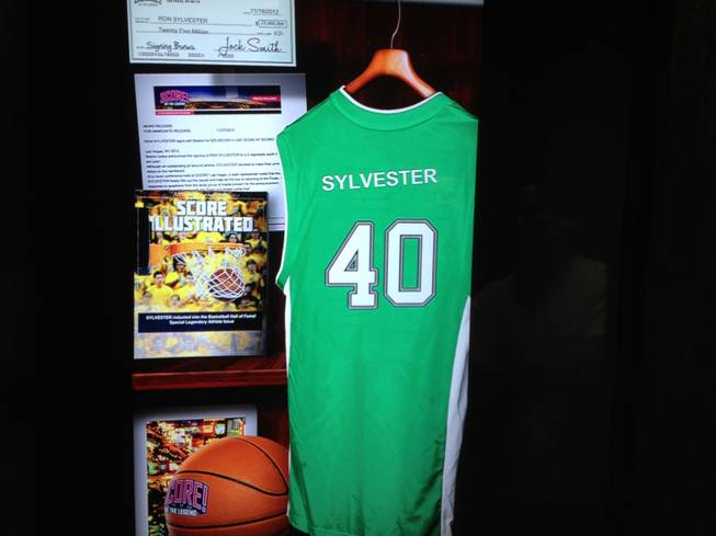 Visitors get a personalized view of what their locker might have looked like as a professional athlete as part of the sports fantasy experience at Score! at the Luxor in Las Vegas.