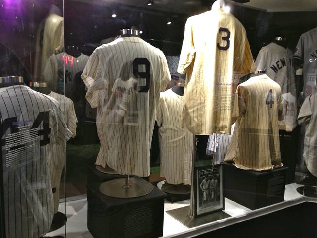 A display of New York Yankees jerseys worn in games by legends, including (from left) Reggie Jackson, Roger Maris, Babe Ruth and Lou Gehrig, are featured at Score!, the interactive fantasy sports exhibit at the Luxor in Las Vegas.