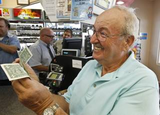 Wes Prinzen, of Fountain Hills, Ariz., smiles as he takes away his modest $4 winnings, at a 4 Sons Food Store where one of the winning tickets in the $579.9 million Powerball jackpot was purchased, Nov. 29, 2012, in Fountain Hills, Ariz.