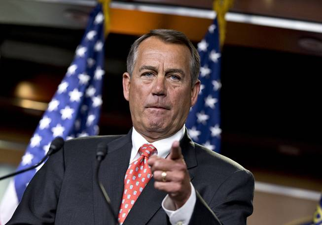 House Speaker John Boehner of Ohio gestures as he speaks to reporters on Capitol Hill in Washington, Thursday, Nov. 29, 2012, after private talks with Treasury Secretary Timothy Geithner on the fiscal cliff negotiations.