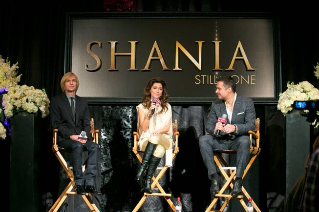 "From left, Costumier Mark Bouwer, Shania Twain and Director Raj Kapoor hold a press conference at Caesars Palace for the upcoming show ""Still The One"", Friday Nov. 30, 2012."