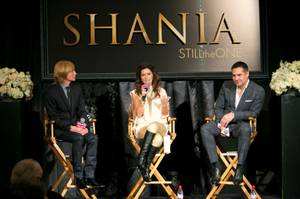 "From left, costumier Mark Bouwer, Shania Twain and director Raj Kapoor hold a press conference at Caesars Palace for their upcoming show ""Still the One"" on Friday, Nov. 30, 2012."