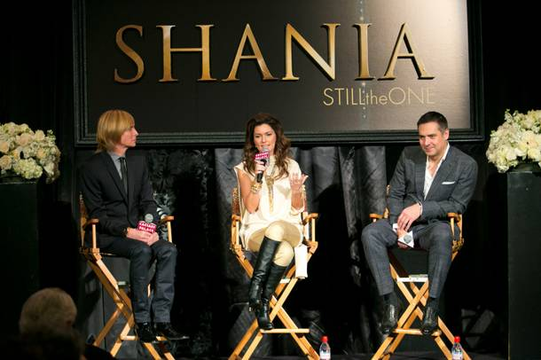 From left, costumier Mark Bouwer, Shania Twain and director Raj Kapoor hold a press conference at Caesars Palace for their upcoming show