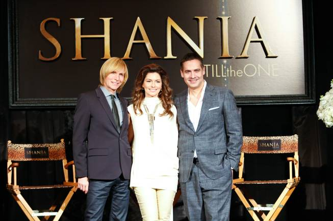 "From left, Costumier Mark Bouwer, Shania Twain and Director Raj Kapoor pose for photos during a press conference at Caesars Palace for the upcoming show ""Still The One"", Friday Nov. 30, 2012."