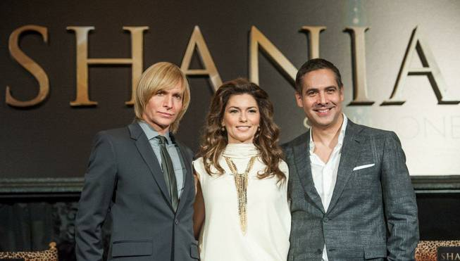Fashion designer Marc Bouwer (in suit and tie), singer Shania ...