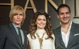 Fashion designer Marc Bouwer (in suit and tie), singer Shania Twain and director Raj Kapoor (suit, no tie) attend a press conference at Caesars Palace on Friday, Nov. 30, 2012.