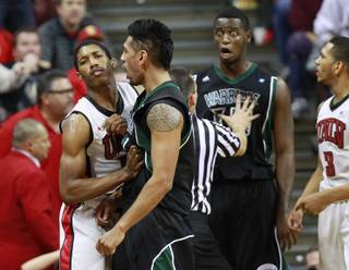 UNLV guard Justin Hawkins shoves Hawaii guard Jace Tavita out of his face while Hawaii center Vander Joaquim reacts to being called for a technical foul during their game Saturday, Dec. 1, 2012 at the Thomas & Mack. Hawkins also received a technical foul for the altercation with Joaquim. UNLV won 77-63