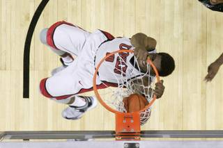 UNLV forward Savon Goodman dunks the ball during their game against Hawaii Saturday, Dec. 1, 2012 at the Thomas & Mack. UNLV won 77-63