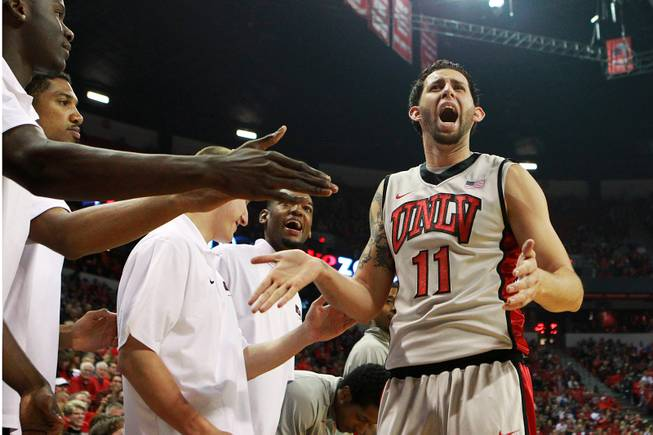 UNLV forward Carlos Lopez-Sosa yells to fans during their game against Hawaii Saturday, Dec. 1, 2012 at the Thomas & Mack. UNLV won 77-63