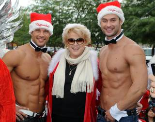 Mayor Carolyn Goodman is flanked by Chippendales at the Rio dancers Sami Eskelin and James Davis, who is competing in Season 21 of CBS'