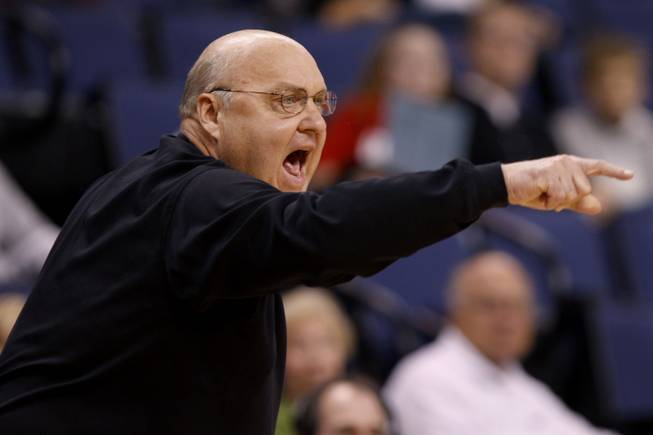 In this photo taken on Friday, Oct. 30, 2009, then-Saint Louis basketball coach Rick Majerus instructs his team during the first half of a preseason NCAA college basketball game against Arkansas Fort-Smith. Majerus died Dec. 1. He was 64.