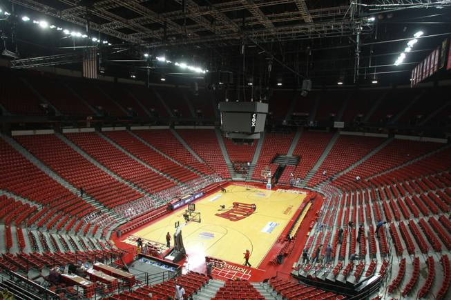 Clean up crews prepare the Thomas & Mack for its hosting of the National Finals Rodeo Dec. 1, 2012.