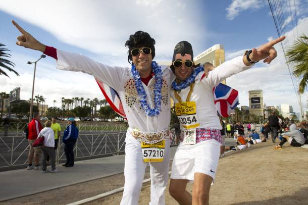 Runners David Gadd, left of Canada and Andy Miller of England strike a pose before the Zappos.com Rock 'n' Roll Las Vegas Marathon Sunday, Dec. 2, 2012.