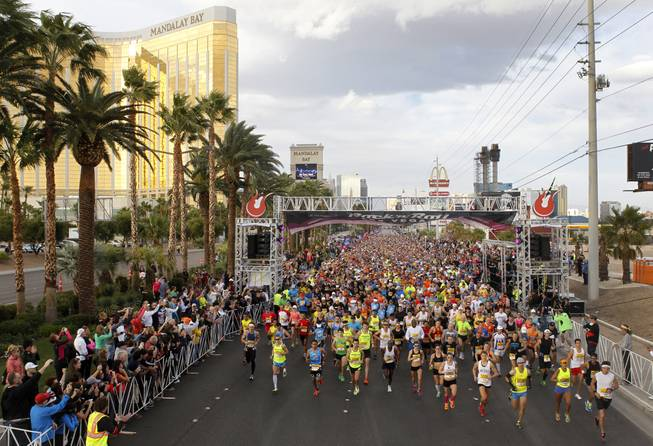 The first group of runners heads out during the Zappos.com Rock 'n' Roll Las Vegas Marathon Sunday, Dec. 2, 2012.