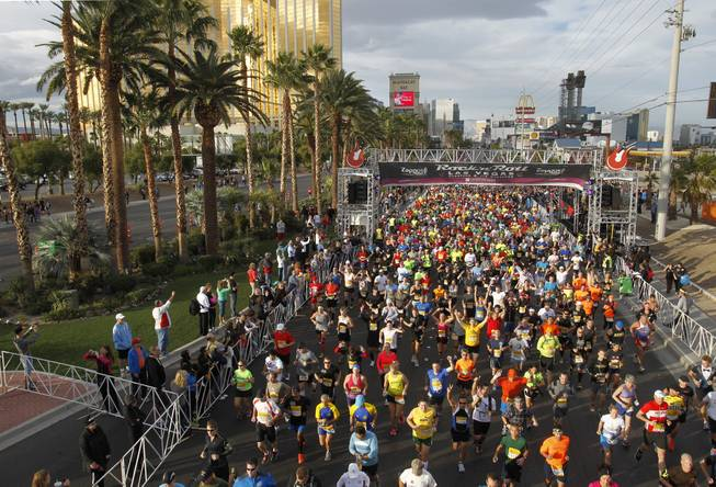 Runners are head out from the start line during the Zappos.com Rock 'n' Roll Las Vegas Marathon Sunday, Dec. 2, 2012.