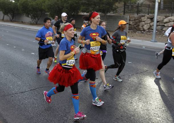 A pair of women with Superman T-shirts run during the Zappos.com Rock 'n' Roll Las Vegas Marathon Sunday, Dec. 2, 2012.