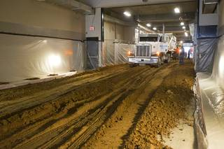 8:00 a.m. - Workers start spreading dirt in the east tunnel as they prepare the Thomas & Mack Center for the National Finals Rodeo Sunday, Dec. 2, 2012. This year's NFR begins Thursday, Dec. 6 and runs through Saturday Dec. 15.