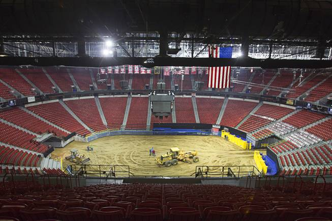 1:30 p.m. - Most of the dirt work is finished on the arena floor as workers prepare the Thomas & Mack Center for the National Finals Rodeo Sunday, Dec. 2, 2012. This year's NFR begins Thursday, Dec. 6 and runs through Saturday Dec. 15.