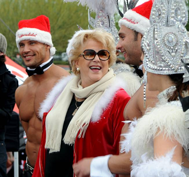 "Mayor Carolyn Goodman is flanked by Chippendales at the Rio dancers Sami Eskelin and James Davis, who is competing in Season 21 of CBS' ""The Amazing Race,"" at the Great Santa Run at Town Square on Saturday, Dec. 1, 2012."