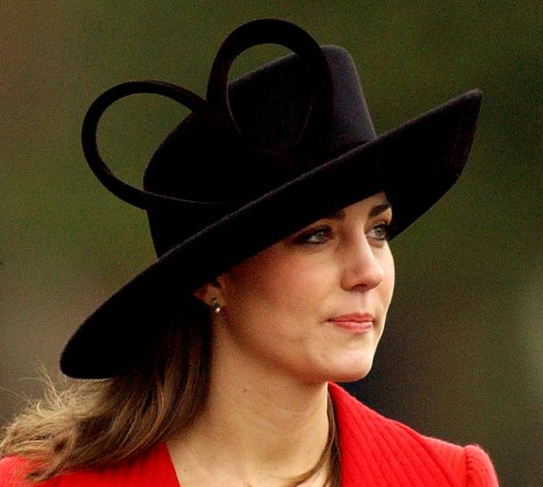 Kate Middleton, a friend of Britain's Prince William wears a hat with a giant heart, as she arrives at the Royal Military Academy, Sandhurst, where graduates,  including the Prince, took part in the Sovereign's parade at the academy,  near Camberley,  England, Friday Dec. 15, 2006. The Prince was commissioned into the Blues and Royals, a regiment of the Household Cavalry.