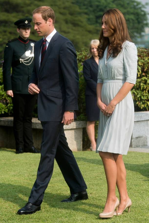 In this Thursday, Sept. 13, 2012 file photo, Britain's Prince William and his wife Kate, the Duke and Duchess of Cambridge, walk together as they visit the Kranji Commonwealth War Memorial in Singapore.