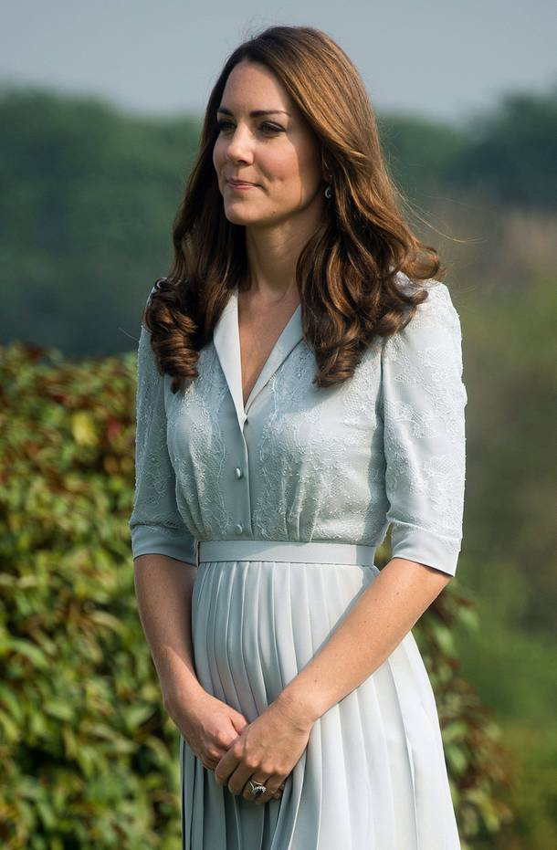 In this Thursday, Sept. 13, 2012 file photo, Kate, the Duchess of Cambridge visits the Kranji Commonwealth War Memorial in Singapore.