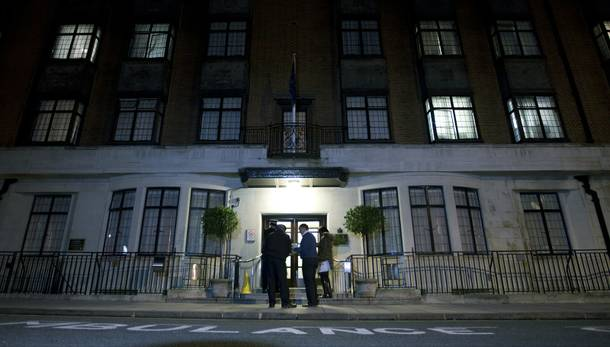 Policeman stand guard outside the King Edward VII hospital where the Duchess of Cambridge has been admitted with a severe form of morning sickness, in London, Monday, Dec.  3, 2012.