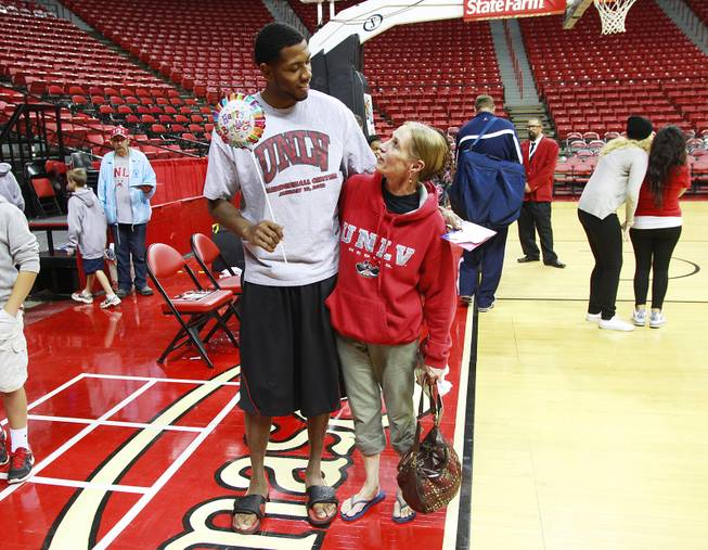 MIke Moser hugs his mother Jeanne Moser while posing for a photo after UNLV's exhibition game against Dixie State Nov. 7, 2012. Jeanne Moser was visiting not only to see Mike play but to celebrate his birthday.