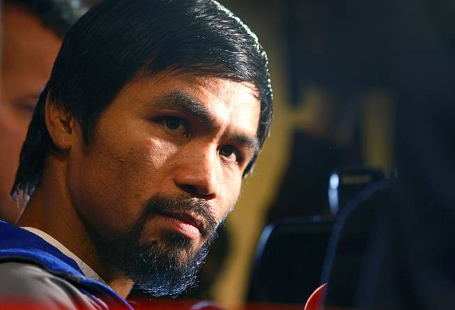 Filipino boxer Manny Pacquiao listens to a reporter's question during an interview at the MGM Grand Tuesday, December 4, 2012. Pacquiao will take on Juan Manuel Marquez of Mexico in a welterweight bout at the MGM Grand Garden Arena on Saturday. It will be the fourth time for the boxers to fight each other.