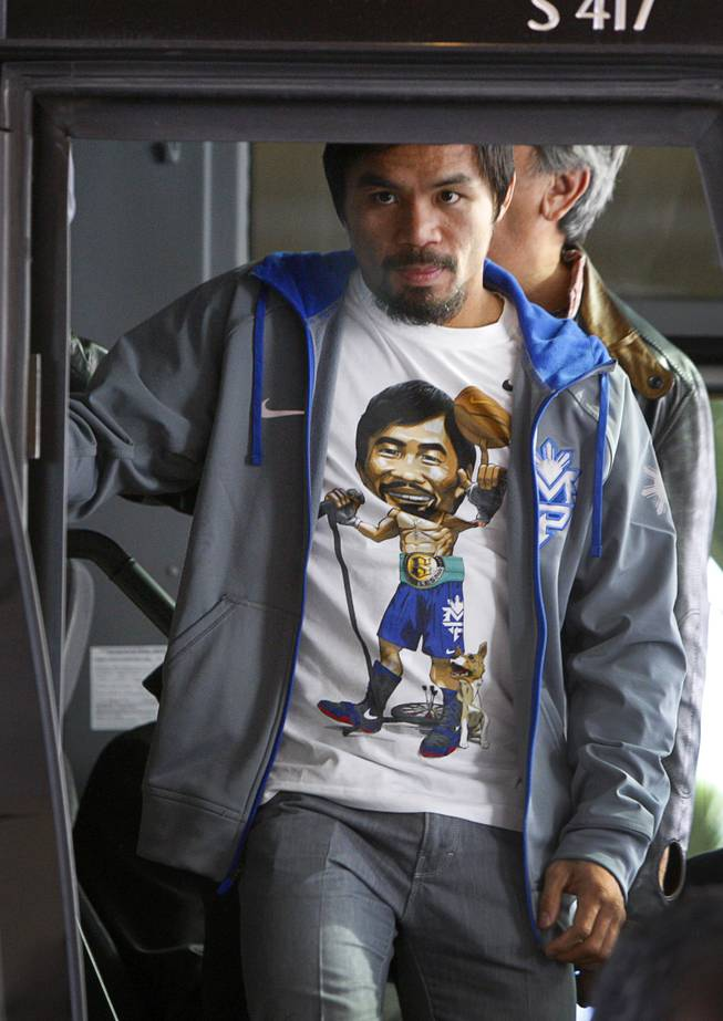 Filipino boxer Manny Pacquiao arrives at the MGM Grand Tuesday, December 4, 2012. Pacquiao will take on Juan Manuel Marquez of Mexico in a welterweight bout at the MGM Grand Garden Arena on Saturday. It will be the fourth time for the boxers to fight each other.