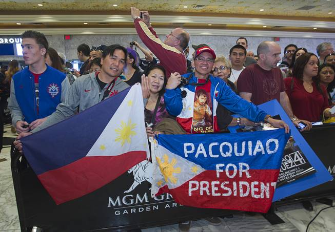 Fans of Filipino boxer Manny Pacquiao wait for Pacquiao to arrive at the MGM Grand Tuesday, December 4, 2012. Pacquiao will take on Juan Manuel Marquez of Mexico in a welterweight bout at the MGM Grand Garden Arena on Saturday. It will be the fourth time for the boxers to fight each other.