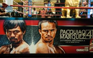 Manny Pacquiao and Juan Manuel Marquez arrive at MGM Grand Las Vegas on Tuesday, Dec. 4, 2012.