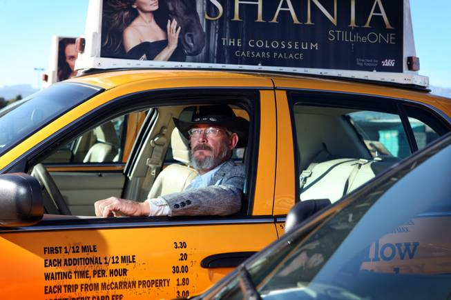Cab driver George Allen sits in a cab at the Yellow-Checker-Star headquarters in Las Vegas on Tuesday, November 20, 2012.