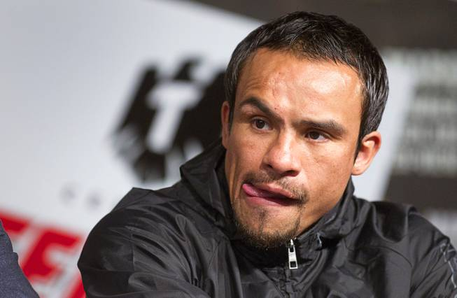 Mexican boxer Juan Manuel Marquez attends a news conference at the MGM Grand Wednesday, Dec. 5, 2012. Marquez and Filipino boxer Manny Pacquiao will fight for a fourth time in a welterweight bout at the MGM Grand Garden Arena Saturday.