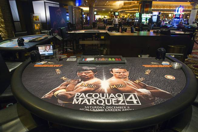 A blackjack table with images of Filipino boxer Manny Pacquiao and Juan Manuel Marquez of Mexico is displayed on the casino floor at the MGM Grand Wednesday, Dec. 5, 2012. Pacquiao and Marquez will fight for a fourth time in a welterweight bout at the MGM Grand Garden Arena Saturday.